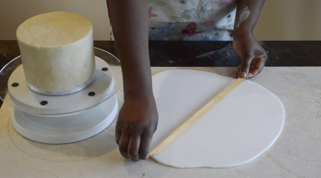 Covering A Cake Board With Sugarpaste